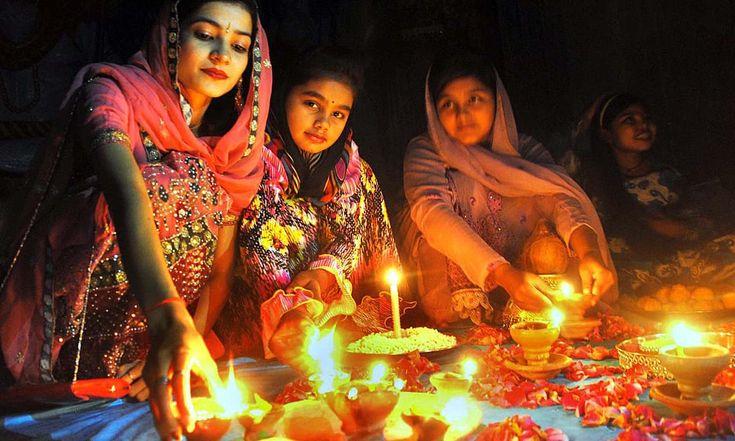 Hindu girls busy in their religious rituals during Diwali Festival in Shiva Mandir at Thandi Sarak. —APP