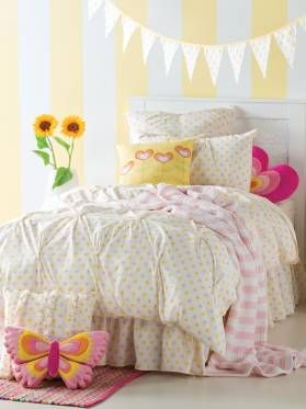 Kids pale yellow and pink polka dot Sandy Bed Pack from Linen House's Hiccups range, available at Forty Winks.