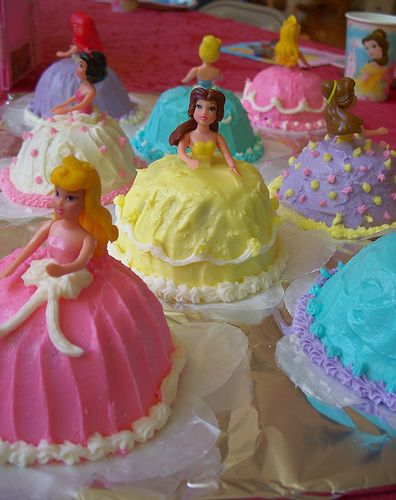 How to make Individual Princess Cupcakes! I would make cupcakes from a mix, ( turn cupcake upside down ) add small plastic princess' and then decorate as you wish.  Click to see more.