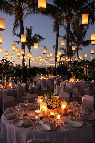 Paper lanterns and glowing candles create such a romantic ambience at this wedding!