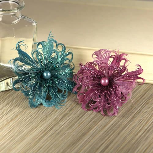 2 Feather Flowers Le Coque  Windsor  552831 - exotic feathers fashioned into flowers with pearl centers - teal green and magenta pink. $4.99, via Etsy.