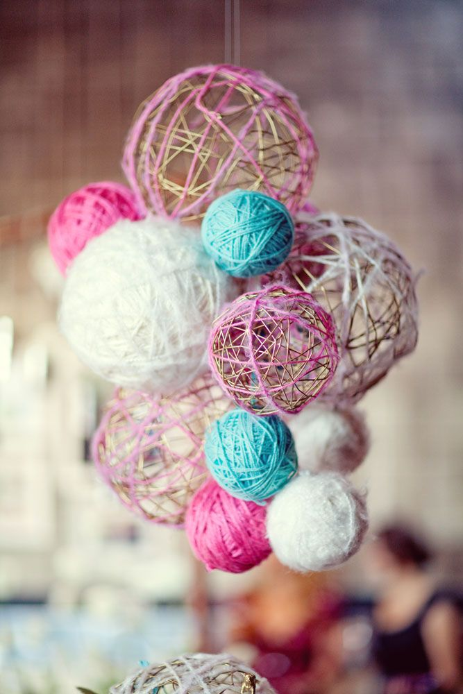 Love the idea of creating various sized yarn balls (esp the hallow ones) in different colors and hanging from the ceiling.