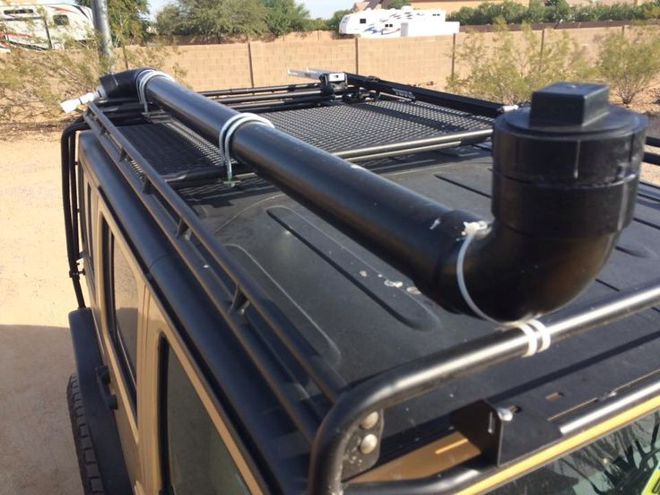 Roof rack camping shower. Easy to make and black ABS pipe will get hot with sun! :-)  - hold the phone. Water storage on the roof. Around the solar panels. Genius.