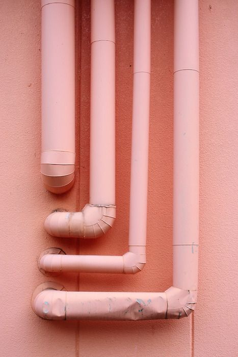/ coral / pink / wall with pipes /