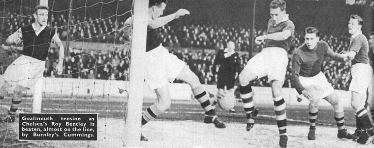 29th October 1955. Chelsea centre forward Roy Bentley is thwarted by Burnley centre half Tommy Cummings' clearance off the line.