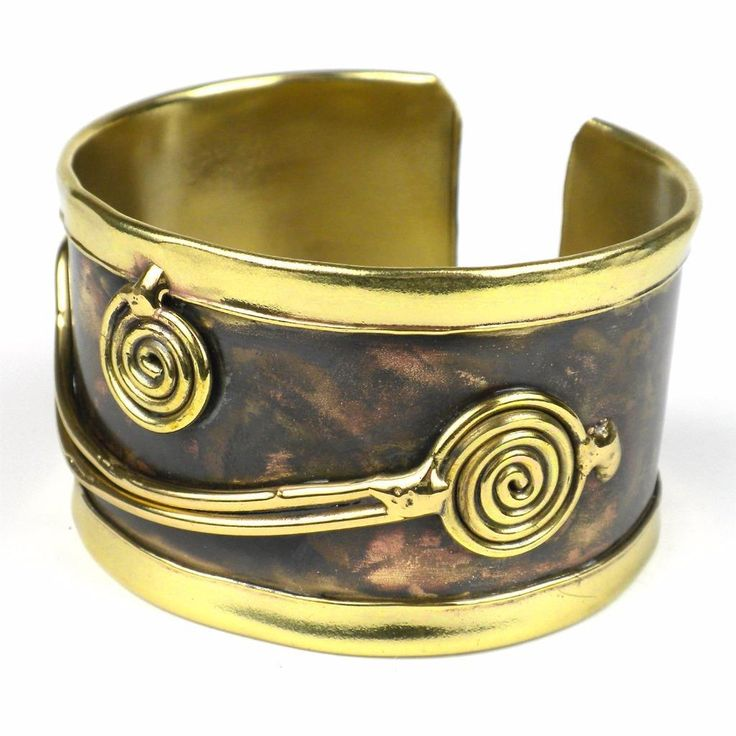 Handcrafted by South African artisans, this darkened brass cuff features swirls of brilliant brass. The feathering and color on this 1.5-inch wide bracelet is achieved by applying extreme heat rather than paints or dyes.