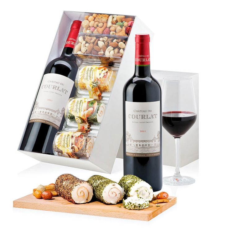 Spread out the contents of this giftbox and you have an instant gourmet celebration: three distinct Primello cheeses - fresh cheese in elegant roll form with salmon, pineapple, and pepper, a gorgeous red wine, tangy Japanese crackers, and nuts.