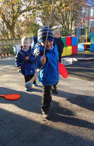 tennis balls in tights - great for gross motor #abcdoes #grossmotor