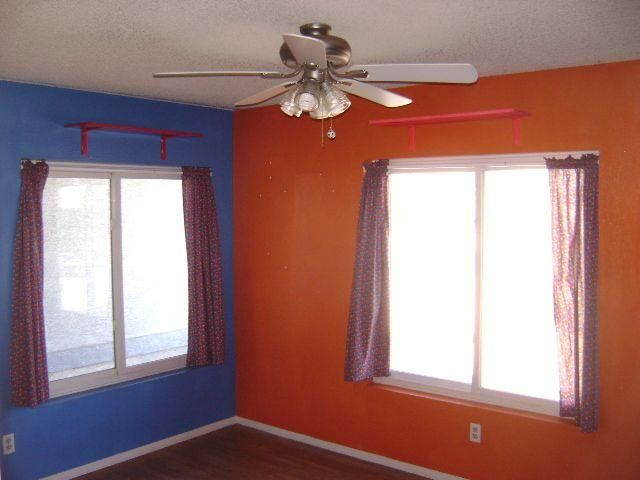 Blue and orange bedroom ugly color choices clash blue for Blue and orange room