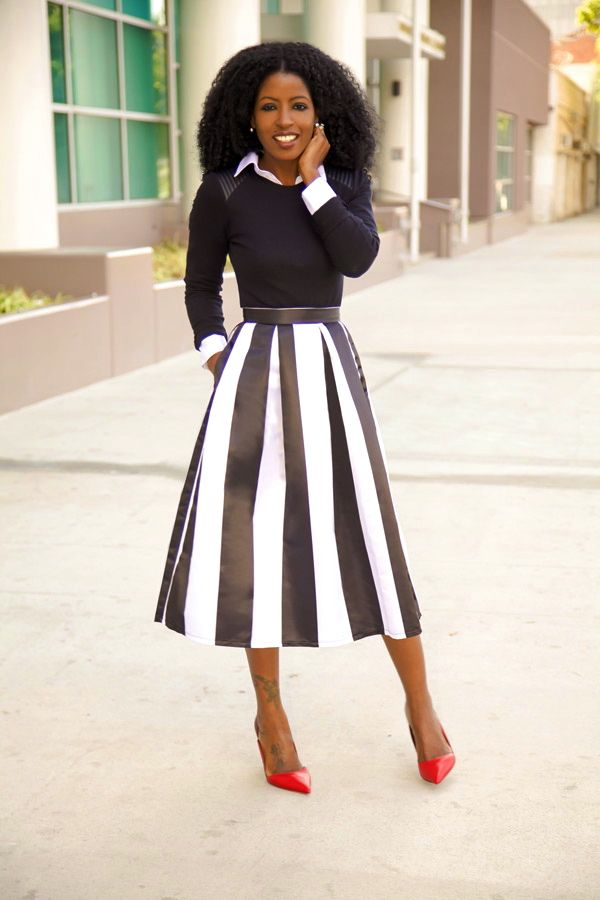 Long sleeve black top, long A-line striped skirt :)