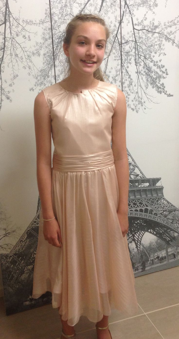 Junior bridesmaid in a high neck, sleeveless metallic blush dress. #angelamannocouture#madetomeasure #couture#bridesmaids