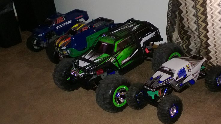 From left to right:  Stampede 1/10 (stock), Stampede 1/10 (custom made all aluminum), Summit 1/10 (stock), Losi Night Crawler 1/10.