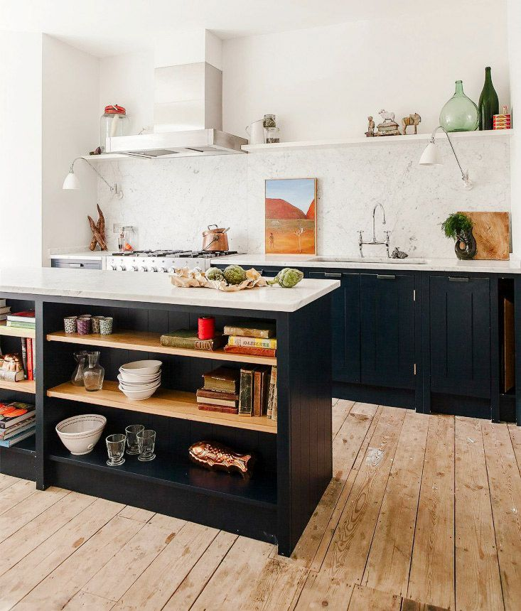 Black and white details with open shelving units in island