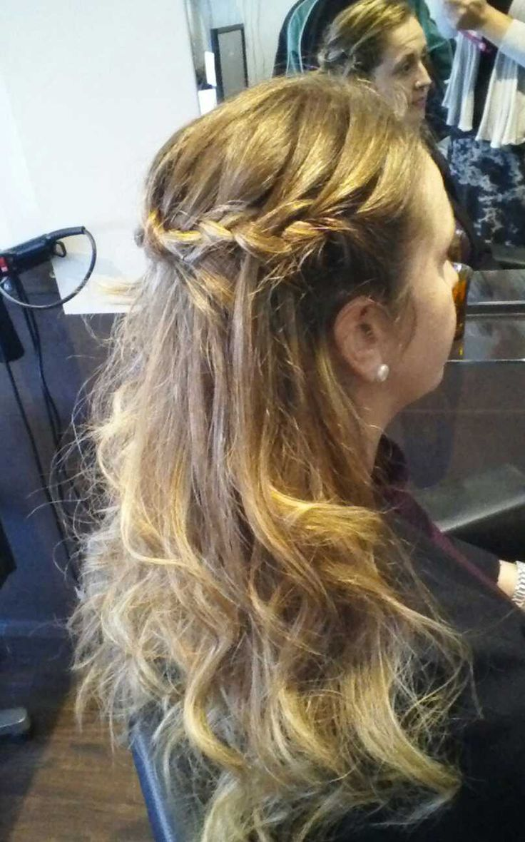 Waterfall braid with curled and wavy hair