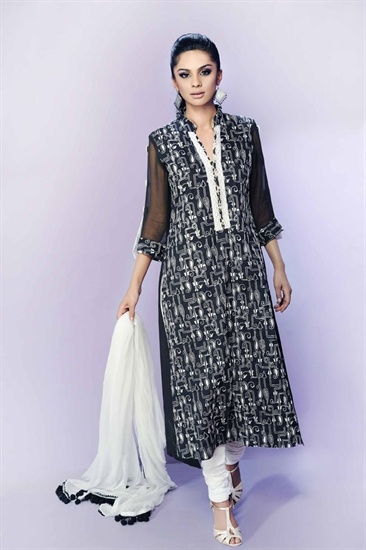 Black and white embroidered cotton kameez with plain white churidar. The kameez has beige and black print lining and border. The sleeves are sleer chifon with a black and white print cuff.  £39.99