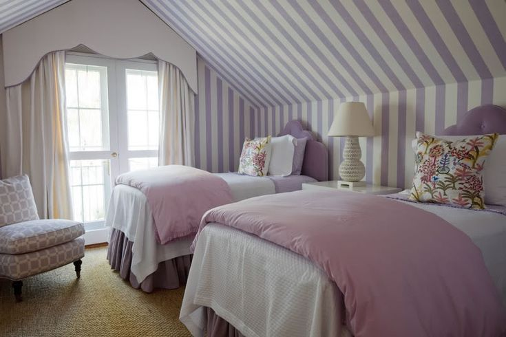 Darling girl's room with twin beds and stripes
