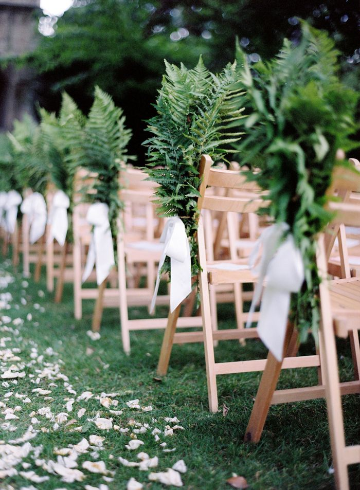 Fern bunches with white ribbon dotty about from the main entrance to the lawn of Woodland Manor