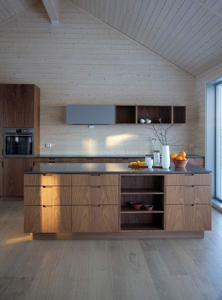 Hamran + Tingbø. Hamran Kitchen. Extraordinary kitchens from Norway. Kitchen inspiration.  Scandinavian design. Silestone worktop. Walnut cabinets. Integrated pulls/cut outs for handles. Cut out kitchen cabinet pulls. Kitchen island. Open shelves. AEG appliances. Hardwood light oak floors.