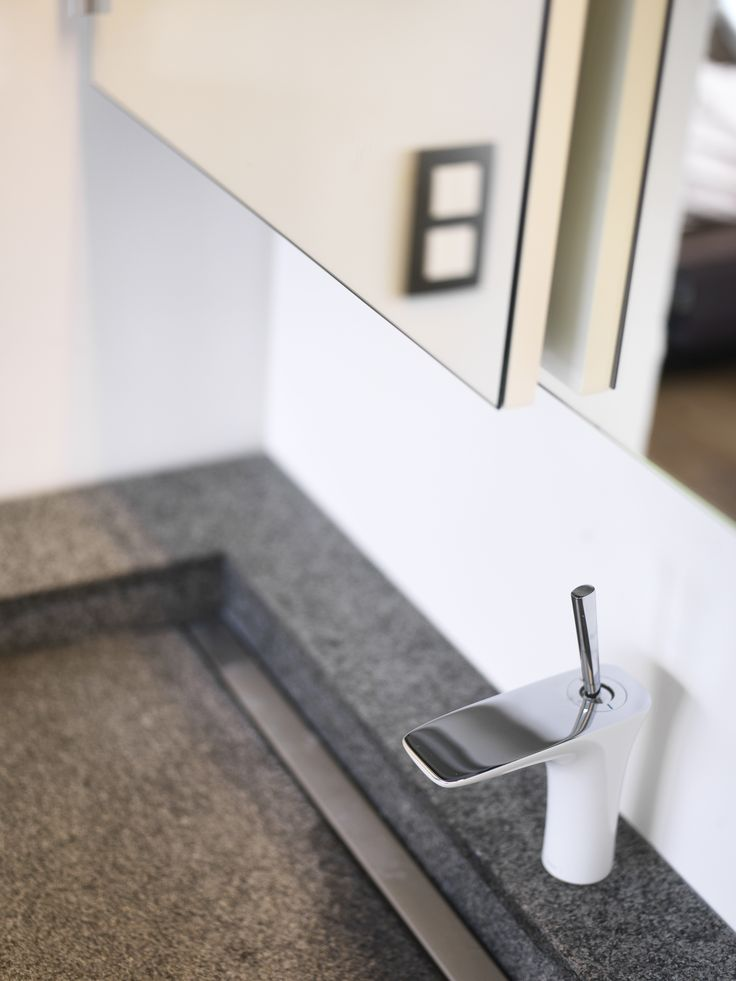 Natural Stone wash basin with brushed grating. I-Drain inside.