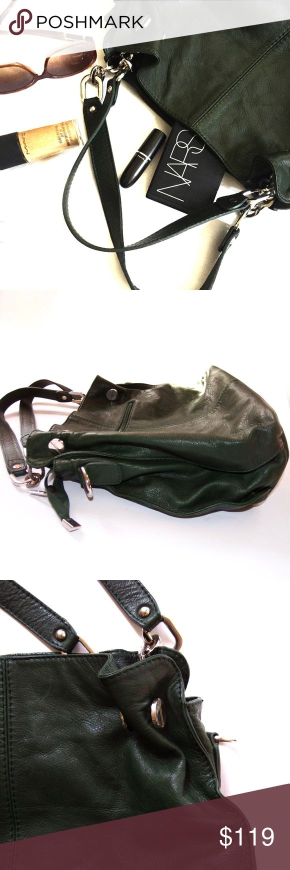 """Borse in Pelle Green Italian Leather Satchel Purse Emerald Green. Soft and supple leather. Silver metal accents. Handcrafted in Italy? Yes Please! Grab this bag for a night out for St. Patty's or to go to the office. Borse in Pelle ( which literally translates to """"Leather Handbags"""" ) is a luxury Italian brand.   Details:  * Buttery soft.  * Silver metal accents.  * Zipper compartment in & out. * The top of the bag zips closed. * Missing the shoulder strap * Only used a handful of times…"""