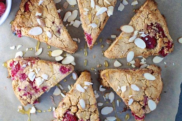 These Gluten Free Raspberry Scones are a delicious addition to any Sunday brunch. Subtly sweetened with a drizzle of raw honey and fresh fruit.
