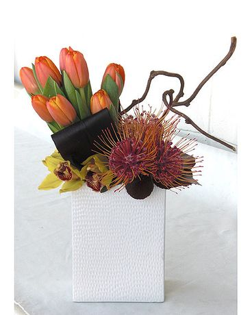 Send the Tulips and Proteas bouquet of flowers from Floral Design by Dave's Flowers in Los Angeles, CA. Local fresh flower delivery directly from the florist and never in a box!