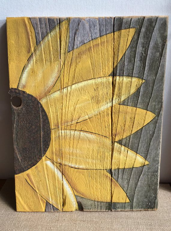 This is a hand painted Sunflower, painted on reclaimed old fence board wood. It measures 10 inches by 13 inches. It has a home made metal hanger on the back. It is painted in arcylic paint and top coated both front and back with a light clear coat matte finish to protect it. Please be aware that this is a rustic piece and the nature of the wood has many flaws. It has dents knot holes and imperfections which add to rustic decor of the item. This is not a new department store item but an old…