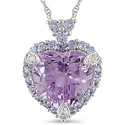 @Overstock - Alluring necklace features a bright purple amethyst heart set amid frosty blue tanzanites  Jewelry shimmers in 10-karat white gold  Heart pendant necklace with icy diamond accents is a beautiful gift for someone special  http://www.overstock.com/Jewelry-Watches/10k-White-Gold-Amethyst-Tanzanite-and-Diamond-accented-Necklace/4409295/product.html?CID=214117 $154.99