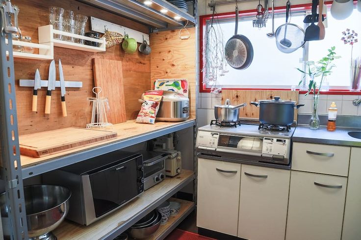 Close up picture - with all kitchen amenities like 2 different types tosters, microwave, rice cooker. In the kitchen you will find all essentional for the house accessories and dishes. Perfect place for those who love cooking in the house.