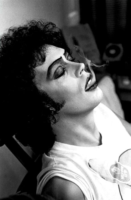 Tim Curry taking a break during the filming of 'The Rocky Horror Picture Show', 1975. Photographed by Mick Rock.