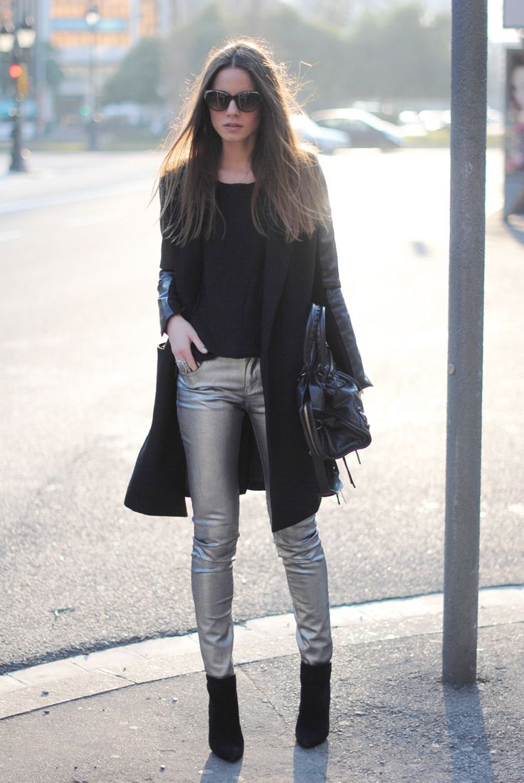 Eccentric silver pants in all-black look.