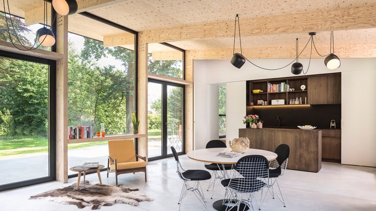 This house in Belgium has been overhauled for a couple of art and book collectors to include a wood-lined living space and plenty of cosy reading nooks.