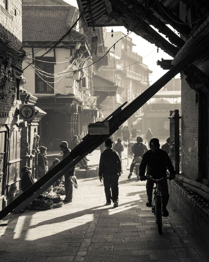 Morning on the streets of Patan the most historic part of Kathmandu and also badly damaged in the 2015 earthquake. The wooden buttresses are holding up the cracked walls of this temple.