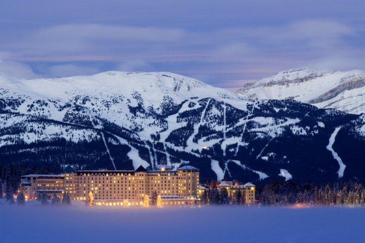 The amazing Chateau Lake Louise with ski resort in the background.