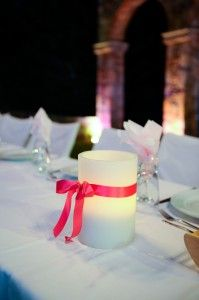 Candle decor with bright pink ribbon - Location Ktima Tritsimpida Greece - Summer Night - Photography Con Tsioukis - ICON PHOTOGRAPHY MELBOURNE - www.iconphotos.com.au