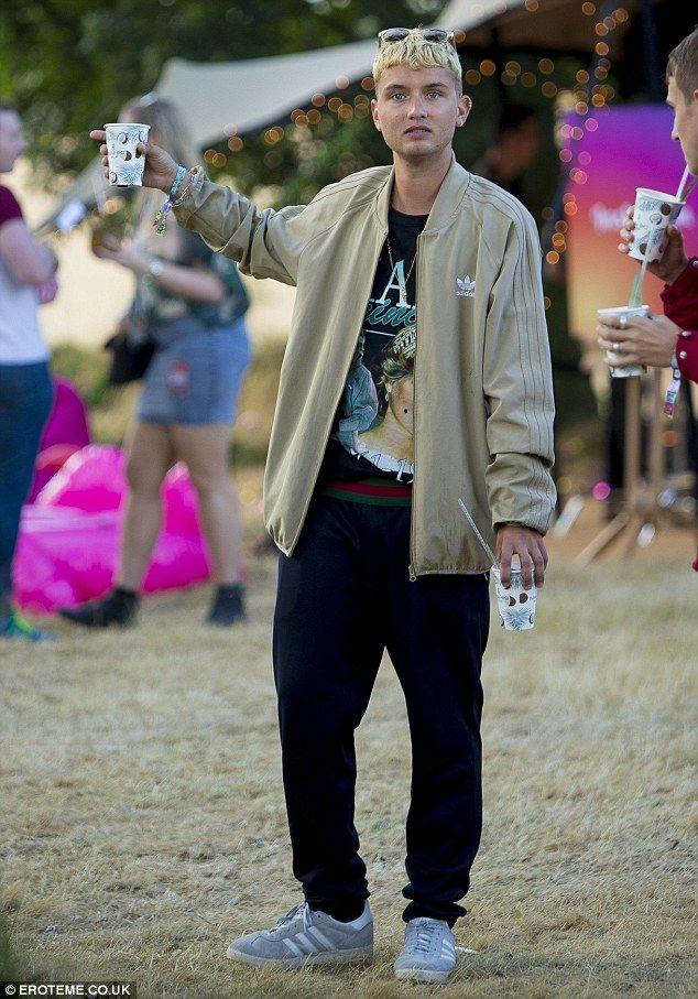 Simple style: Rafferty Law, Jude Law's oldest child with ex-wife Sadie Frost, cut a casual figure in an Adidas tracksuit top and baggy blue jogging bottoms while partying at V Festival on Sunday