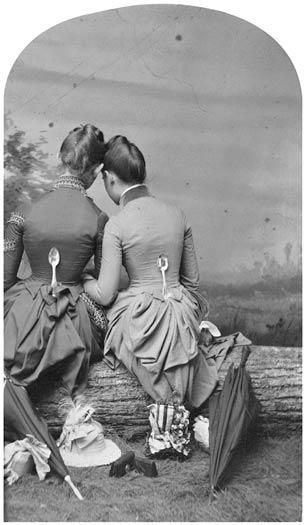 Strange 1860 tintype of women with spoons on their back