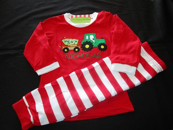 Boy personalized Christmas tractor pajamas are created in Christmas red. This…