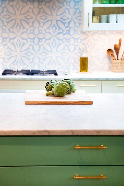green island, marble countertops and blue tile backsplash