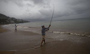Local fisherman during a steady rain as Hurricane Patricia approaches Puerto Vallarta, Mexico