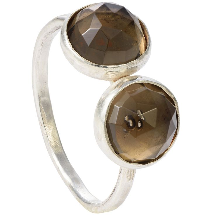 "Two smoky quartz gemstones adorn this simple but powerful ring. The large rose cut stones reflect light on their triangular facets. The side-by-side stones look classy, simple and out of the ordinary.  The faceted cabochons perfectly wrap around the finger and match with the necklace from our ""Two"" collection."