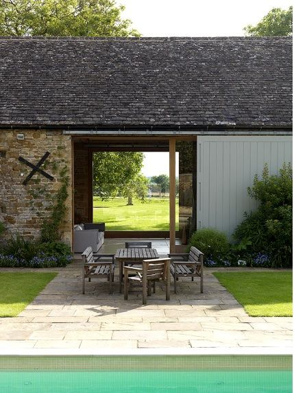 Outdoor dining at the manor by Michaelis Boyd Associates in Oxfordshire : Remodelista