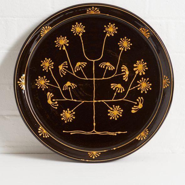 Large Black Slipware Plate (Starburst) by Hannah McAndrew; Scottish slipware artist.