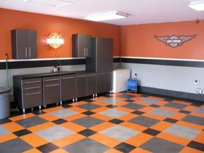 ADVERTISEMENTS Like what you see in the featured photo? That's a garage makeover. They used Harley colors to accomplish a Harley-themed garage. Click the link for more photos of this cool 4-car garage. Harley Davidson Garage ADVERTISEMENTS