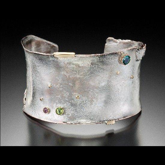 Ronald Linton - Reticulated silver cuff with gold detailing and stone settings.
