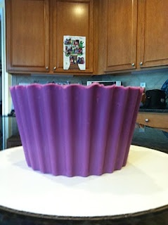 Edible liner for the giant cupcake. Glad I found this....trying it out for Shela's wedding in October (: