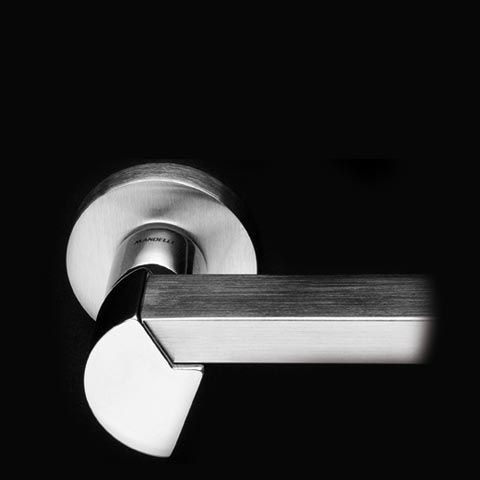 SPY series 1150.  ALL MADE IN ITALY.  All Solid Brass.  Designed by Pier Francesco Arnone.  Produced by Officine Mandelli1953 Maniglie - Door Handles / Levers.  Photo by Davide Bordogna.  Since 1953 our products are the highest expression of Italian craftmanship in the world of luxury house.