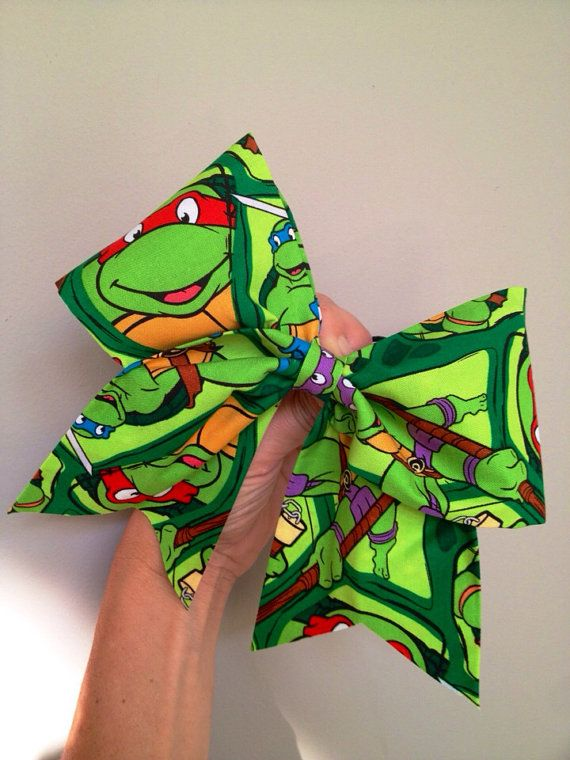 Teenage Mutant ninja turtles Cheer Bow Made with fabric and it has glitter sparkle! Big! Free Shipping! I also take custom orders
