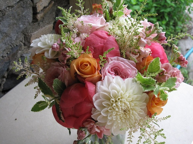 One of our favorite bouquets of 2011: Coral peonies, white dahlias, orange and pink roses, mint, astilbe