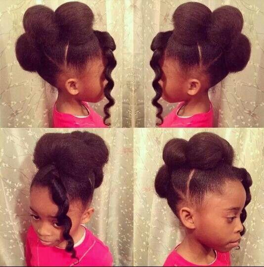 Little girl with cinnamon bun hair and bangs #cute #natural #hair #style